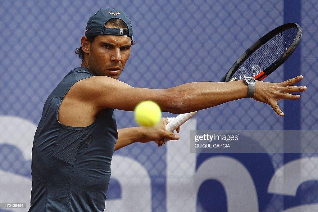 Spanish tennis player Rafael Nadal hits a return during a ...