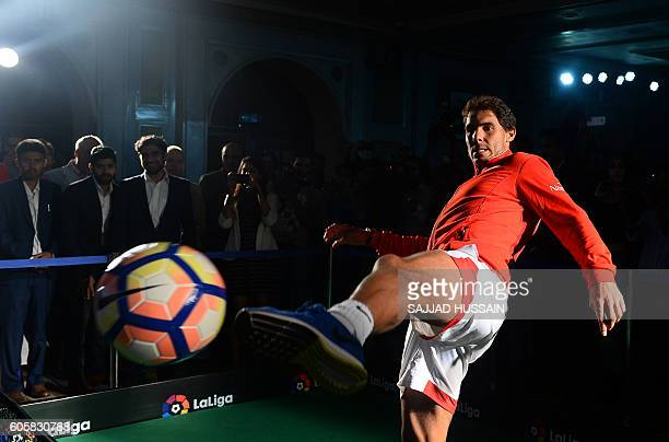 TOPSHOT Spanish tennis player Rafael Nadal plays with a football at a function to promote the Spanish football league in New Delhi on September 15...