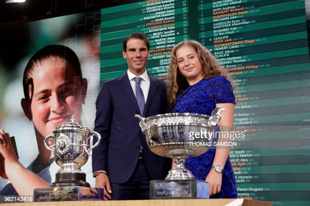 Spanish tennis player Rafael Nadal poses with Latvia's tennis player Jelena Ostapenko after the official draw ceremony for the Roland Garros 2018...