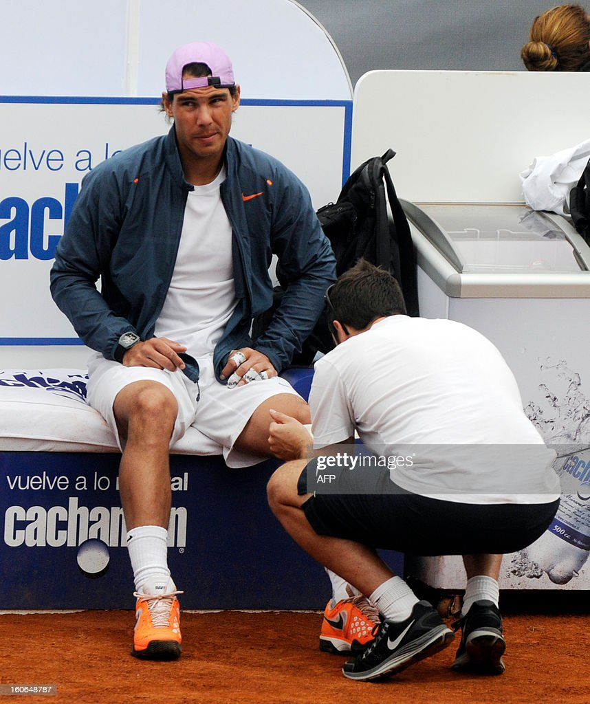 Spanish tennis player Rafael Nadal receives a massage before a training session in Vina del Mar, about 120 km west of Santiago,Chile, on February 4 ,2013. Nadal, an 11-time Grand Slam winner, is preparing to take part in the ATP event in Vina del Mar. Nadal returns to competitive tennis after seven months on the sidelines due to a knee injury.
