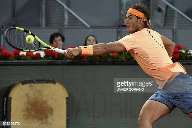 Spanish tennis player Rafael Nadal returns a ball to Portuguese tennis player Joao Sousa during the Madrid Open tournament at the Caja Magica sports...