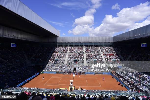 Spanish tennis player Rafael Nadal returns a ball to Serbian tennis player Novak Djokovic during their ATP Madrid Open semifinal match in Madrid on...