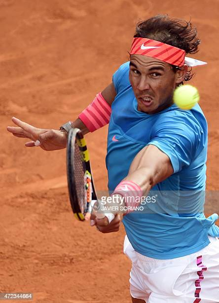 Spanish tennis player Rafael Nadal returns a ball to US tennis player Steve Johnson during the Madrid Open tournament at the Caja Magica sports...