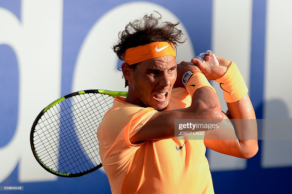 Spanish tennis player Rafael Nadal returns the ball to Japanese tennis player Kei Nishikori during the final of the ATP Barcelona Open 'Conde de Godo' tennis tournament in Barcelona on April 24, 2016. Rafael Nadal equalled Argentine legend Guillermo Vilas's record of 49 clay-court titles with his ninth Barcelona Open after overcoming defending champion Kei Nishikori 6-4, 7-5 today. LAGO