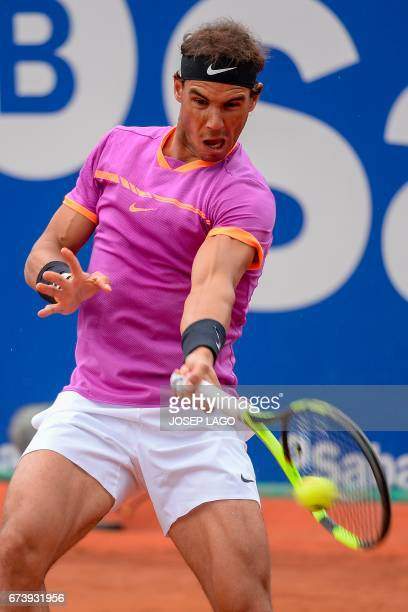 """Spanish tennis player Rafael Nadal returns the ball to South African tennis player Kevin Anderson during the ATP Barcelona Open """"Conde de Godo""""..."""