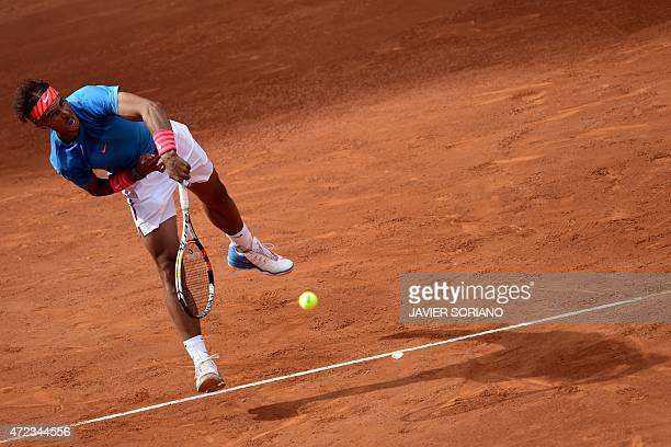Spanish tennis player Rafael Nadal serves a ball for US tennis player Steve Johnson during the Madrid Open tournament at the Caja Magica sports...