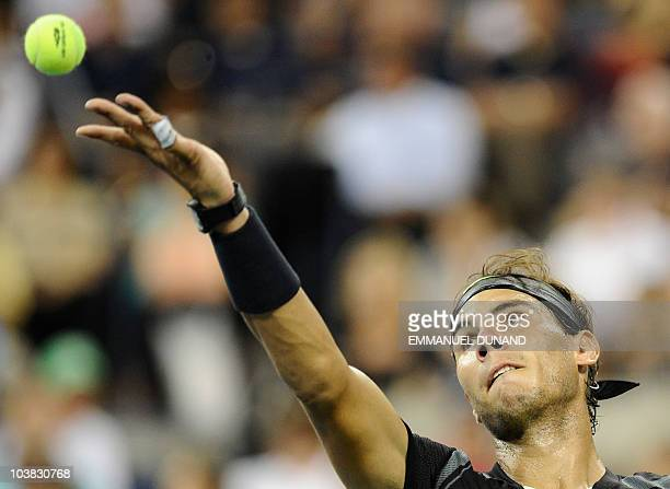 Spanish tennis player Rafael Nadal serves a point to Uzbekistan's Denis Istomin, during their second round match at the 2010 US Open tennis...