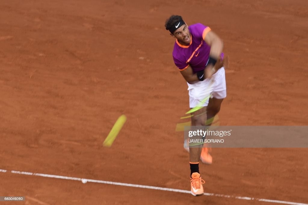 Spanish tennis player Rafael Nadal serves to Austrian tennis player Dominic Thiem during their ATP Madrid Open final match in Madrid, on May 14, 2017. Nadal won 7-6 and 6-4. /