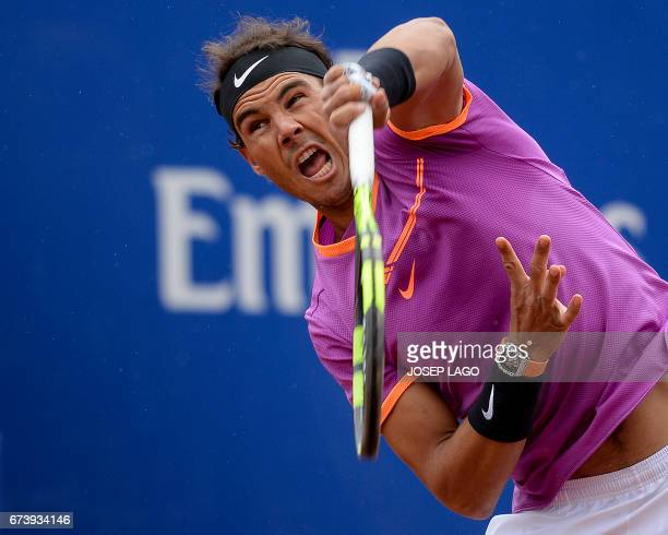 Spanish tennis player Rafael Nadal serves to South African tennis player Kevin Anderson during the ATP Barcelona Open 'Conde de Godo' tennis...