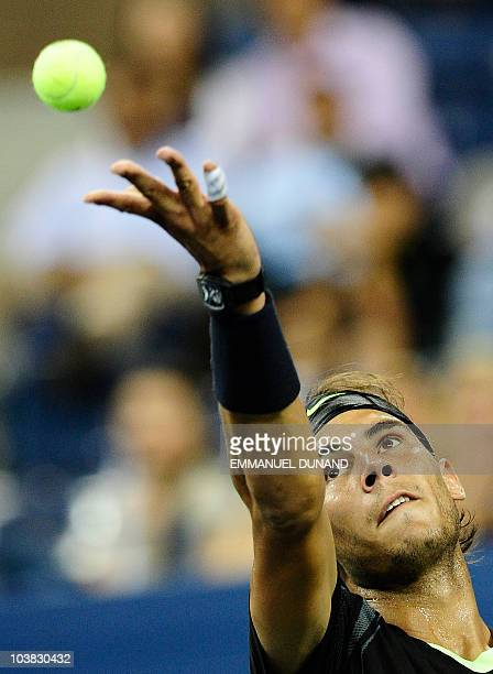 Spanish tennis player Rafael Nadal serves to Uzbekistan's Denis Istomin during their second round match at the 2010 US Open tennis tournament...