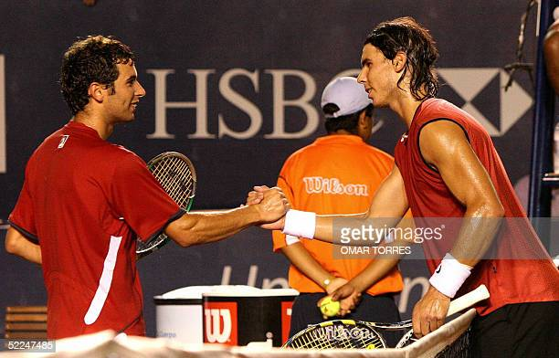 Spanish tennis player Rafael Nadal shake hands with countryman Albert Montanes after winning the Mexican Open's final, 26 February, 2005 in Acapulco,...