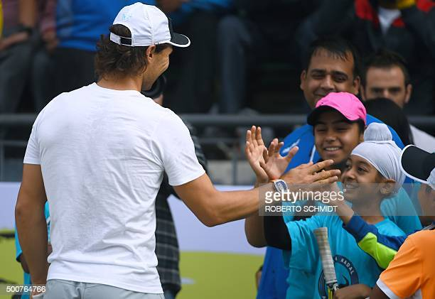 TOPSHOT Spanish tennis player Rafael Nadal shakes hands with Indian Junior tennis players at the end of a tennis clinic in New Delhi on December 10...