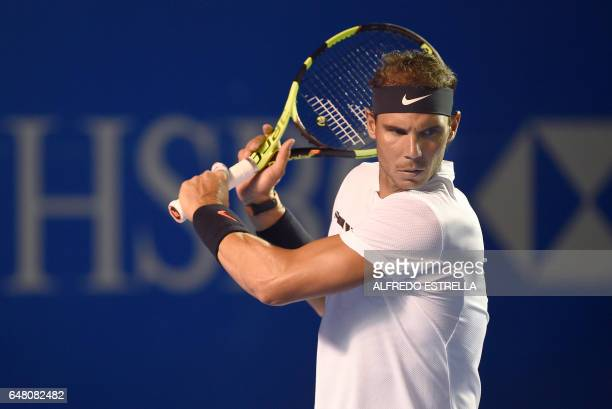 CORRECTION Spanish tennis player Rafael Nadal waits for the ball of US tennis player Sam Querrey duringduring the doubles finals of ATP of the...