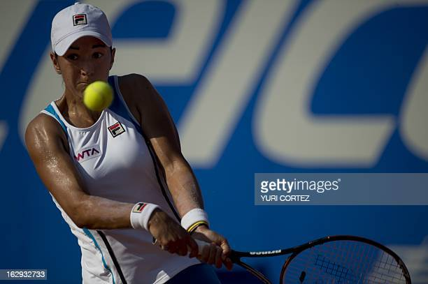 Spanish tennis player Silvia Soler hits a return to compatriot Carla Suarez during their WTA Mexican Open semi-final match, in Acapulco, Guerrero...