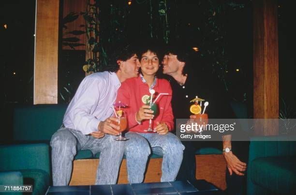 Spanish tennis playing siblings Emilio Arantxa and Javier Sánchez drinking cocktails at the Stade Roland Garros Paris 1988