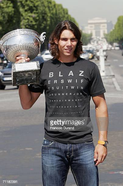 Spanish tennis star Rafael Nadal poses with his trophy in the Place de la Concorde on June 12 2006 in Paris France Nadal won the French Open final...