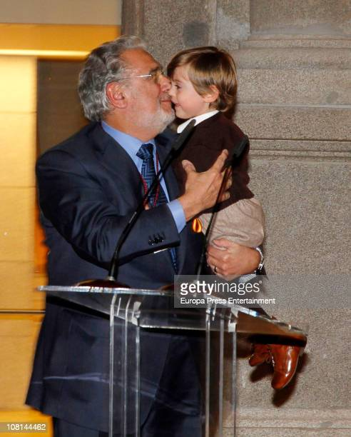 Spanish tenor Placido Domingo carrying his grandson in his arms is awarded with Order of Arts and Letters by Spanish Culture Minister Angeles...