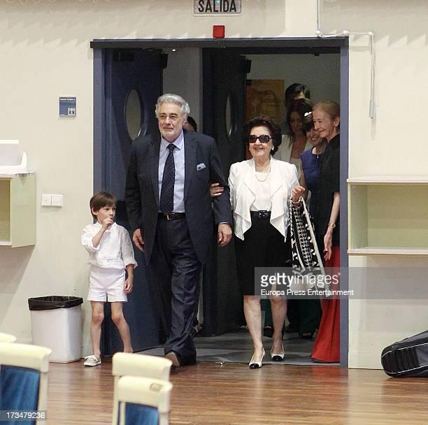 Spanish tenor Placido Domingo his wife Marta Ornelas and his grandson attend a press conference before attending a dress rehearsal of Daniel Catan's...