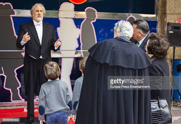 Spanish tenor Placido Domingo , his wife Marta Ornelas and their grandsons watch Placido Domingo's wax figure during its presentation on January 23,...