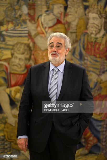 Spanish tenor Placido Domingo poses during a meeting with Spain's King Juan Carlos at the Zarzuela Palace in Madrid on July 29 2013 Domingo is...