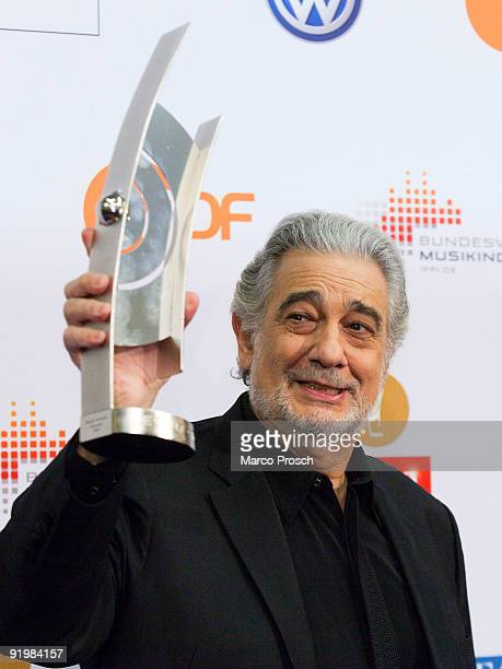 Spanish tenor Placido Domingo poses with his Klassik Echo award on October 18, 2009 at the Semper Opera in Dresden, Germany.