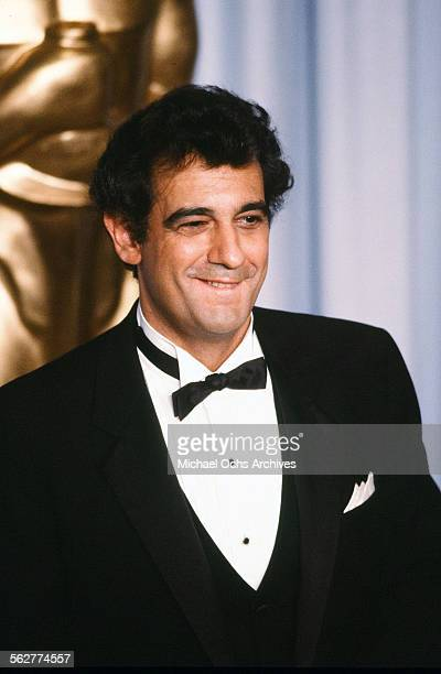 Spanish tenor singer Placido Domingo poses backstage during the 55th Academy Awards at Dorothy Chandler Pavilion Los Angeles California