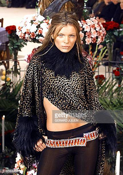 Spanish top model Esther Canadas wears an imitation leopardskin cape with collar and cuffs of Mongolian goathair over transparent stretch pants and...