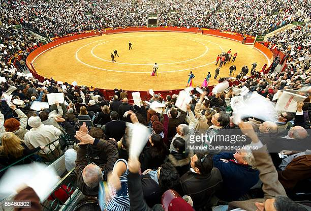 Spanish torero Francisco Rivera Ordonez acknowledges the applauding fans as the bull he was fighting lies dead after performing a bullfight at the...
