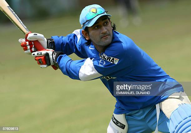 Spanish Town, JAMAICA: Indian cricket player Mahendra Dhoni prepares for a hit during the Indian team's first full practice since landing in the...