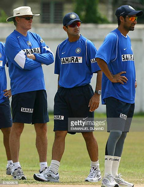 Spanish Town, JAMAICA: Indian cricket team coach Greg Chapell , captain Rahul Dravid and Mohammad Kaif watch a teammate deliver a ball during the...