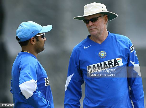 Spanish Town, JAMAICA: Indian cricket team coach Greg Chapell talks with batsman Virender Sehwag during the Indian team's first full practice since...