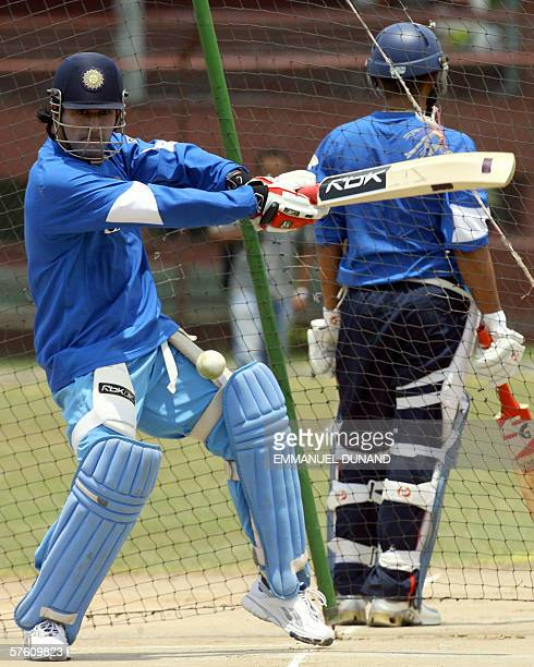 Spanish Town, JAMAICA: Indian team cricket wicketkeeper Mahendra Dhoni eyes a shot during the Indian team's first full practice since landing in the...