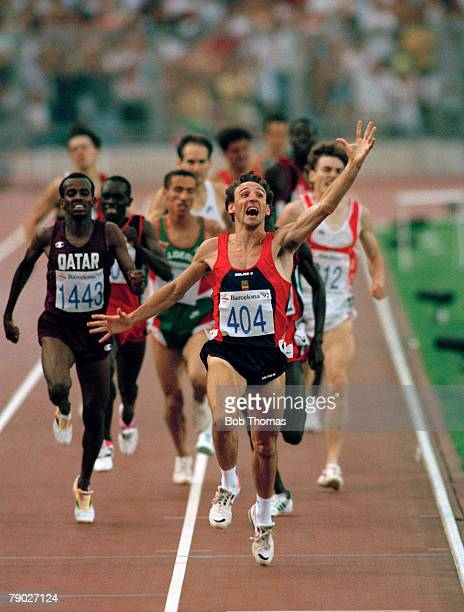 Spanish track athlete Fermin Cacho celebrates as he crosses the finish line in first place to win the gold medal in the final of the Men's 1500...