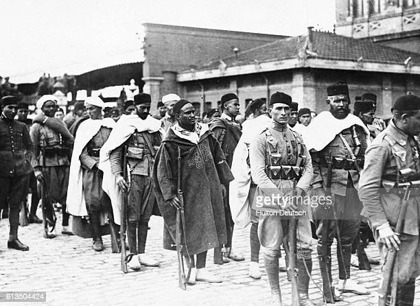 Spanish troops arrive in Madrid where the King of Spain welcomes them with thanks for withstanding a ten day siege during a battle in Morocco |...
