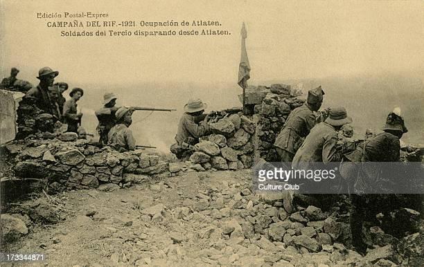 Spanish troops firing from the atlaten hills in an engagement in the Rif War Caption reads 'ocupacion de Atlaten Soldados del Tercio disparando desde...