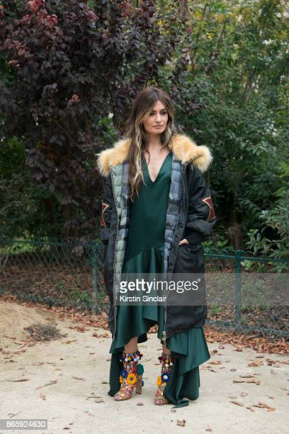 Spanish TV host Angela Rosas Saiz aka Madame de Rosa wears a Project Force parka jacket JCPA Jares dress and Dolce and Gabbana shoes day 2 of Paris...