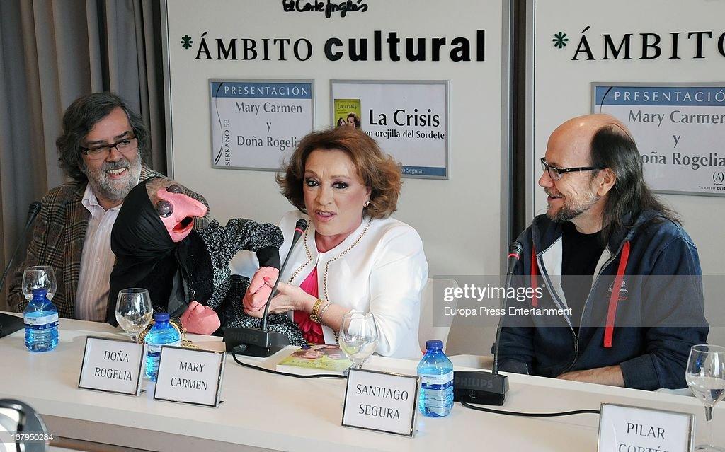 Spanish ventriloquist Mari Carmen (C), her doll Dona Rogelia and Santiago Segura (R) present the book 'La Crisis En Orejilla Del Sordete' on April 30, 2013 in Madrid, Spain.