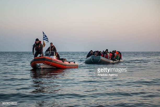 Spanish volunteers are seen on a boat as refugees on another boat come closer to the nearest beach in the southeast of the Lesbos Island Greece on...
