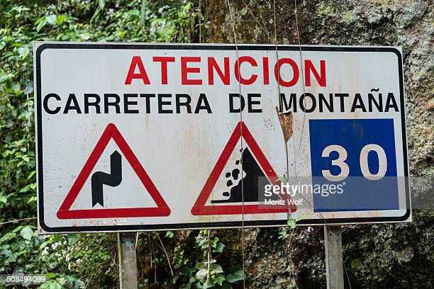 Spanish warning sign of dangers in the mountains, Barranco del Agua canyon, Laurel Forest of Los Tilos, La Palma, Canary Islands, Spain