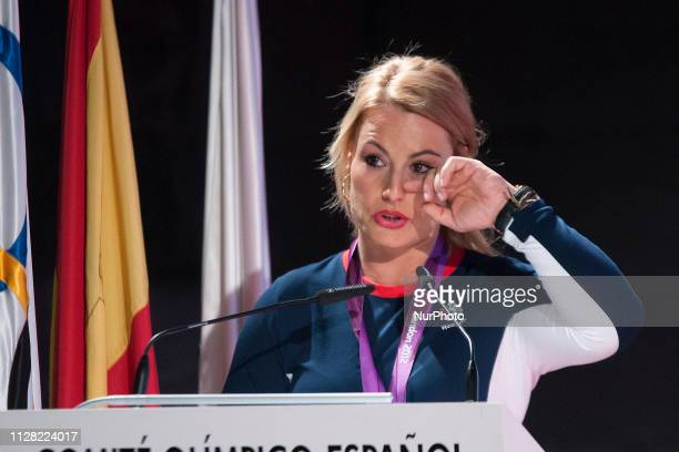Spanish weightlifter Lydia Valentin poses with her London 2012 Olympic Games gold medal during a ceremony held at the Spanish Olympic Committee's...