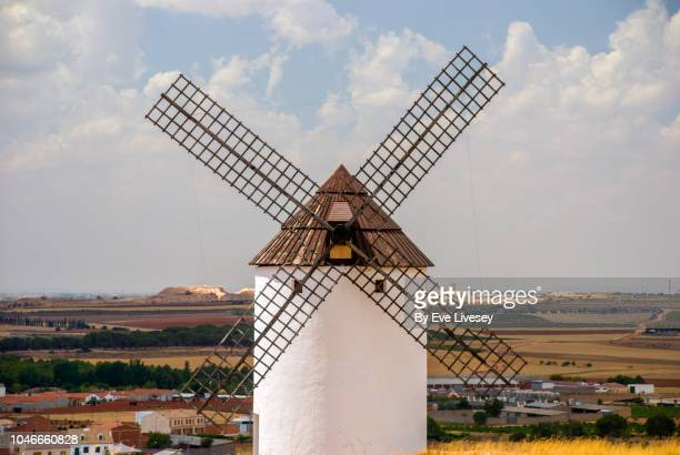 spanish windmill & view of the town - old windmill stock photos and pictures