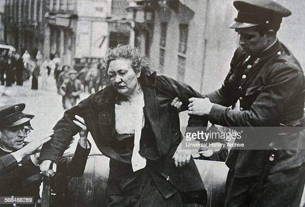 Spanish woman is injured and helped by Assault guards in Madrid during riots in the 1936 Election Assault Guards enforced security on election day...