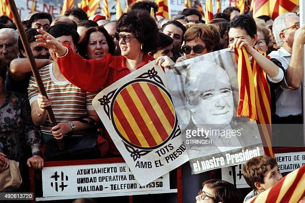 Spanish women hold poster with the effigy of Josep Tarradellas as they welcome him on October 23 1977 in Barcelona on his return from exile Spanish...
