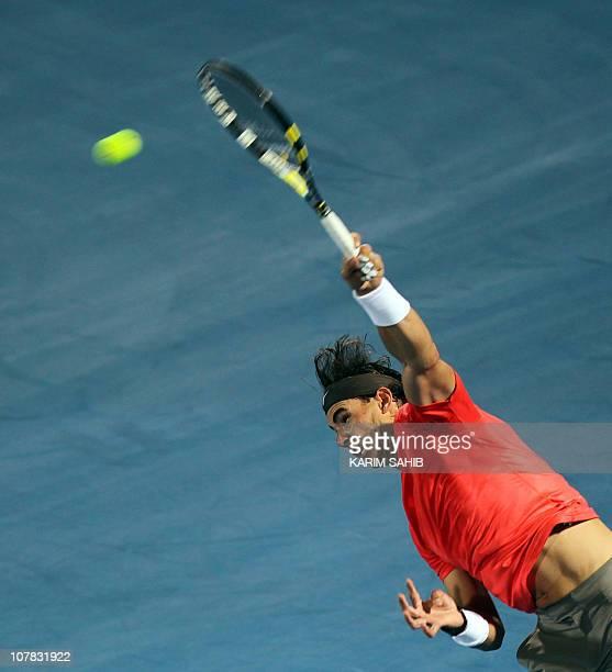 Spanish world number one Rafael Nadal serves to opponent Czech Tomas Berdych during their Mubadala World Tennis Championship semifinal match in Abu...