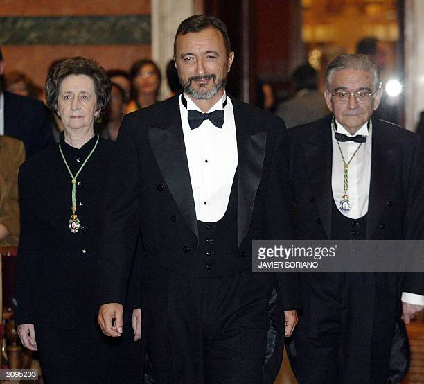 Spanish writer Arturo Perez Reverte accompany by regular members of the 'Real Academia de la Lengua Espanola' Margarita Salas and Luis Angel Rojo...