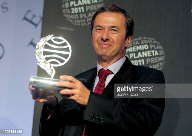 """Spanish writer Javier Moro poses after winning Spain's 2011 Premio Planeta award for his book """"El imperio eres tu"""" on October 15, 2011 in Barcelona...."""