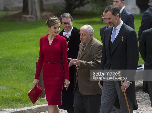 Spanish writer Juan Goytisolo walks flanked by Spain's Queen Letizia and Spain's King Felipe VI after receiving the Cervantes Literature award at the...