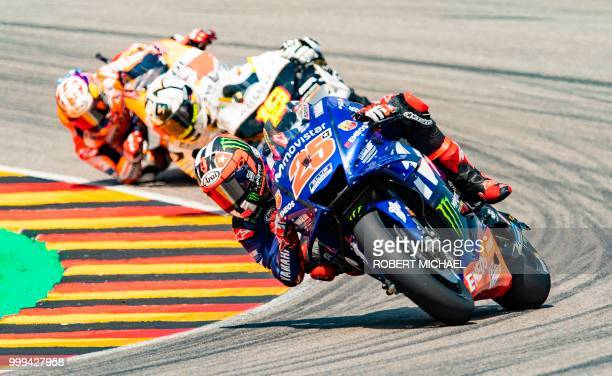 Spanish Yamaha rider Maverick Vinales competes to placed third in the Moto GP race at the Grand Prix of Germany at the Sachsenring Circuit on July...