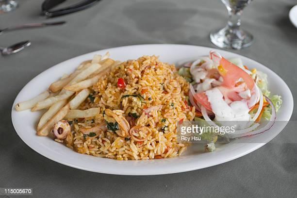 Spanish yellow rice with calamari, fries and salad
