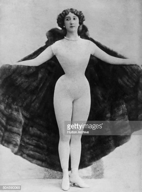 Spanishborn dancer actress and courtesan La Belle Otero wearing a fur cape over a body stocking Paris circa 1895